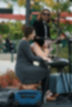 two musicians playing guitar & keyboard in the Stoney Creek Parkette