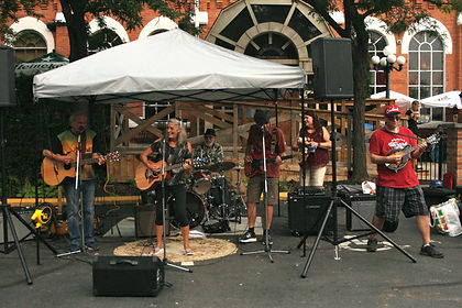 Musicians playing live music in The Powerhouse parking lot