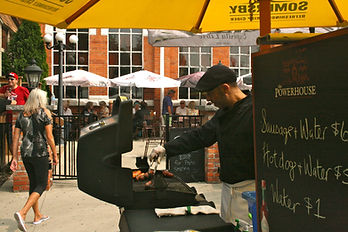 A staff member BBQing outdoors on The Powerhouse patio