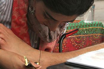 A woman doing Henna