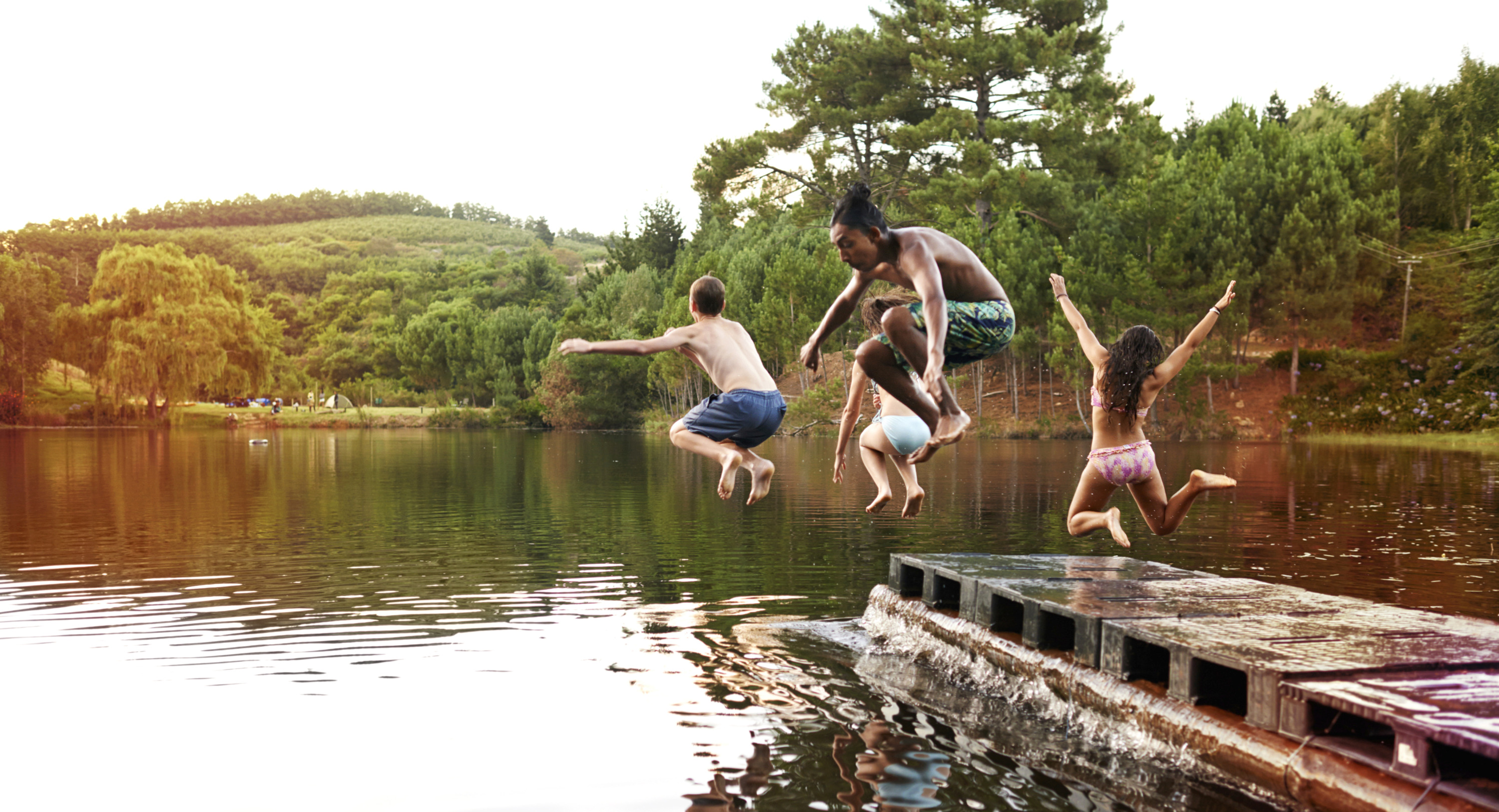 Kids%20Jumping%20into%20the%20Lake_edited.jpg
