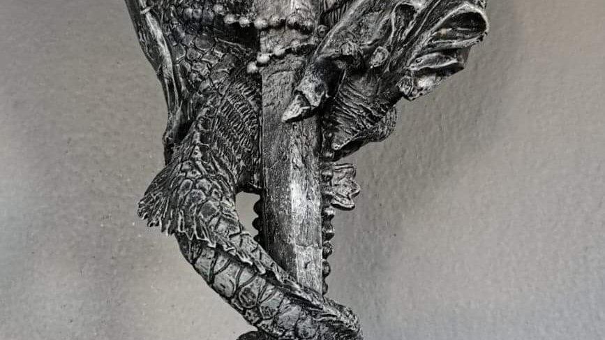 Dragon on sword statue
