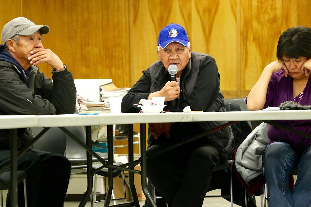 Thomas Kendo and Ruby McDonald listen as John Norbert shares his thoughts