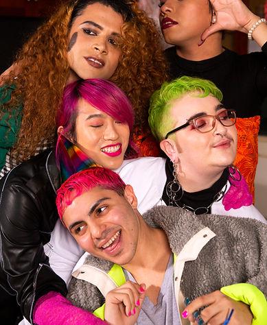 A group of friends of varying genders taking a selfie.