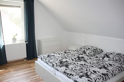 Ferienhaus Erdbeere Schlafzimmer 1 Bild1