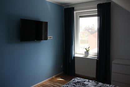 Ferienhaus Erdbeere Schlafzimmer 1 Bild3
