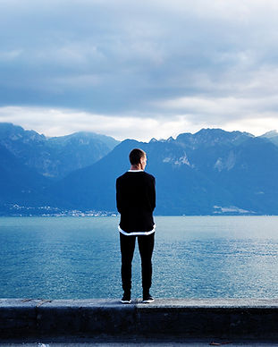Man Looking Out to the Mountains