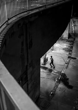 Runner under bridge