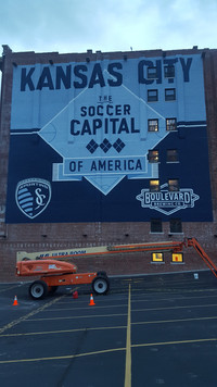 Sporting KC sign Evolution Sign and Mura