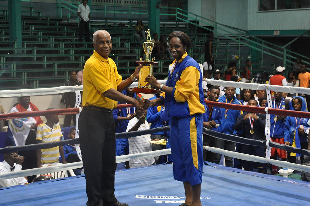 Kimberly Gittens, Barbadian boxer, receiving an award