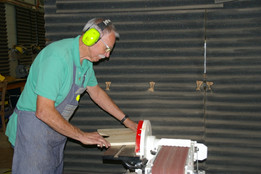 Wozz doing a bit of shaping on the sander...