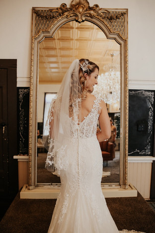 Lillian West wedding dress with lace
