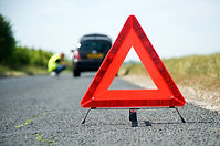 Red warning triangle with a broken down