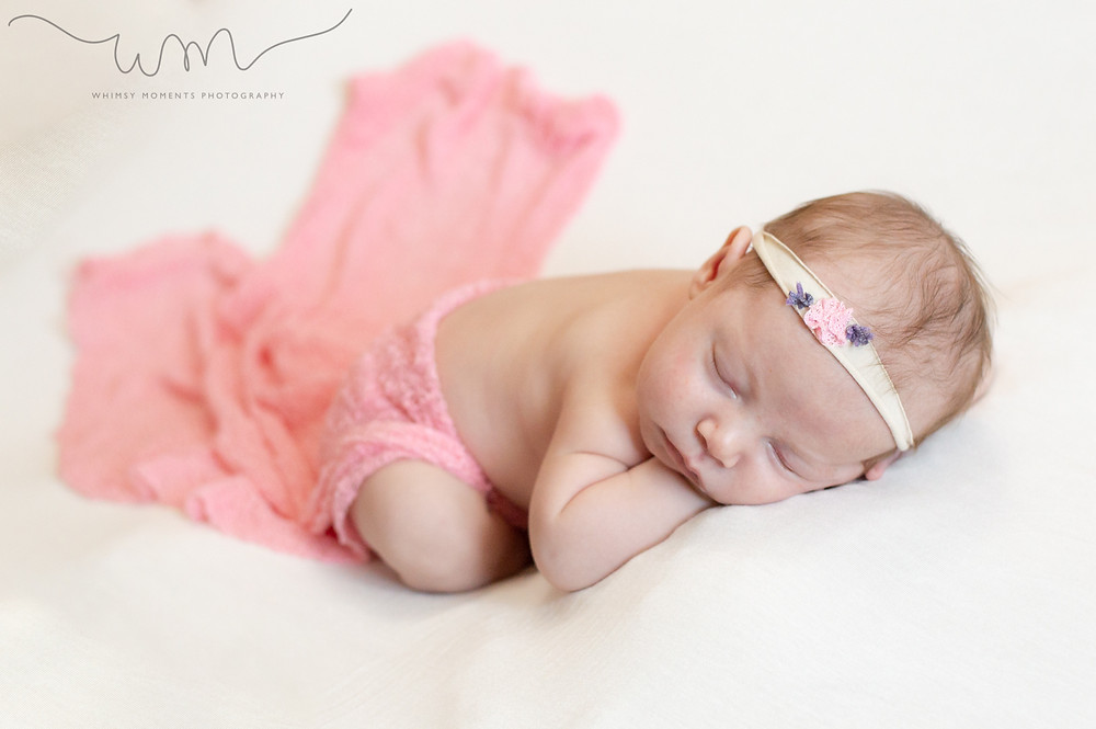 Newborn session in Akron, Colorado baby Girl by Whimsy Moments Photography