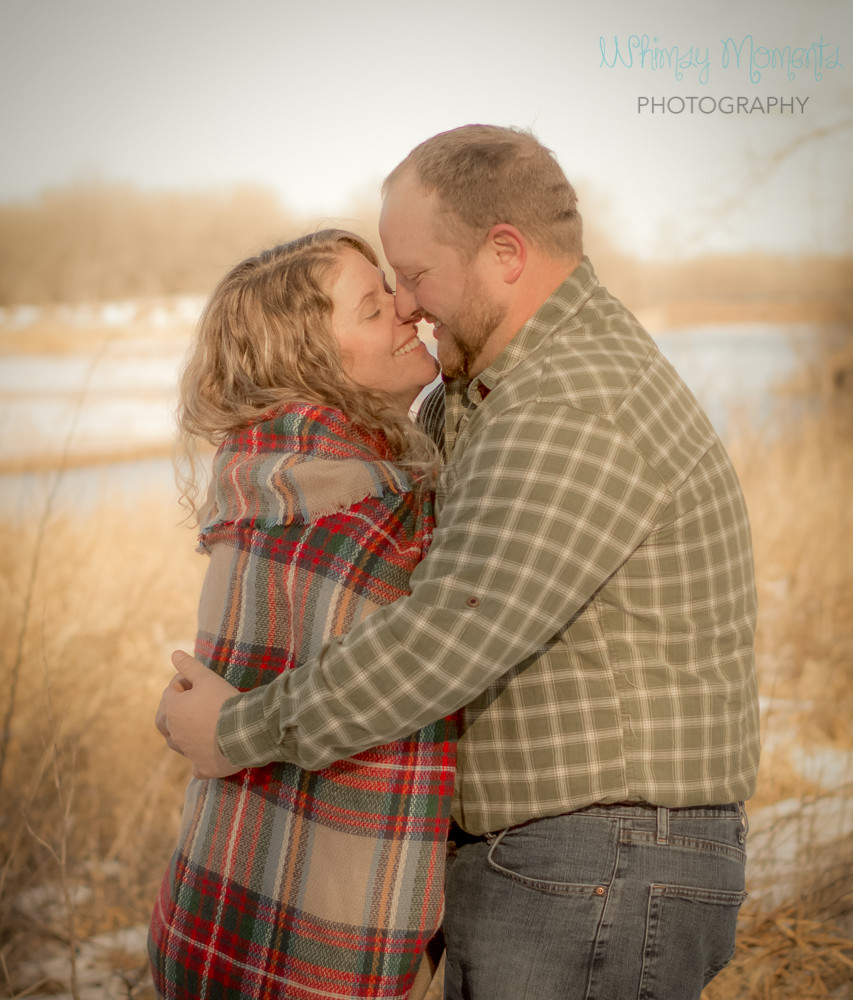 Beautiful engagement session in the winter by the river in Brush Colorado
