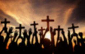 Group of People Holding Cross and Praying in Back Lit.jpg