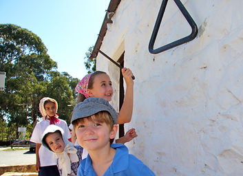 Children ringing school bell Canberra