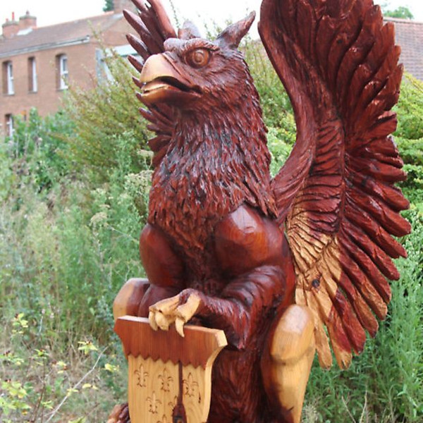Photograph of redwood griffin sculpture by Luke Chapman, at Paston College, North Walsham