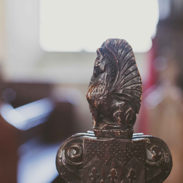 Carved griffin pew end at Paston church