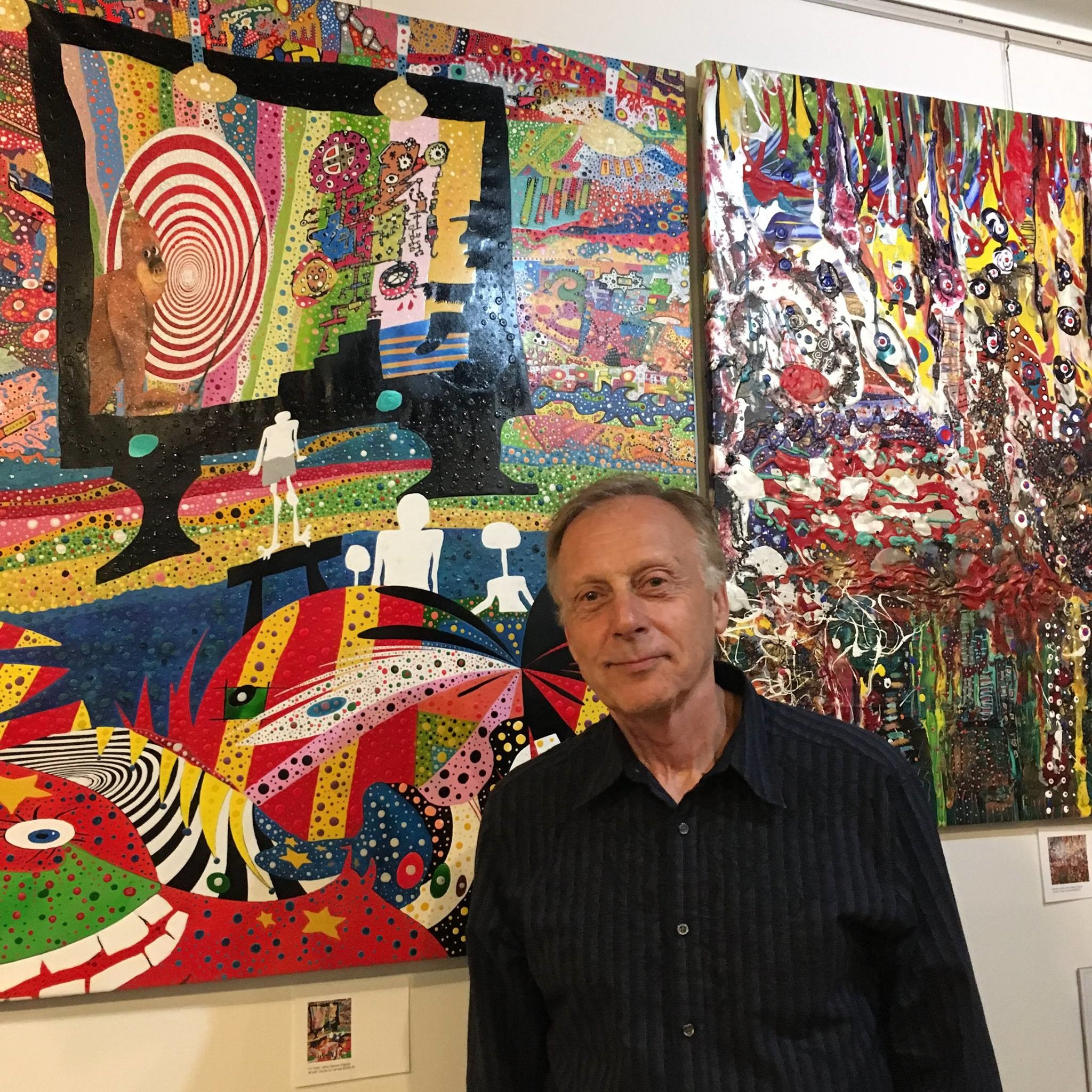 Johny Deluna in front of his art