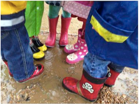 Kids Playing with Boots in Mud