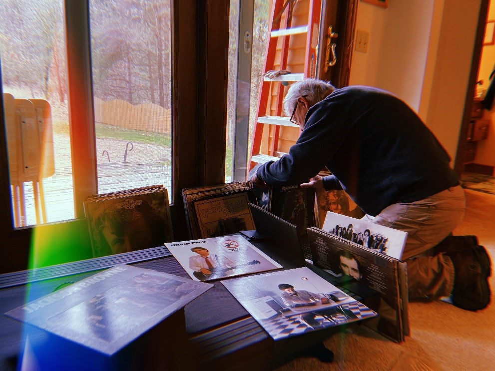 My dad organizing his records