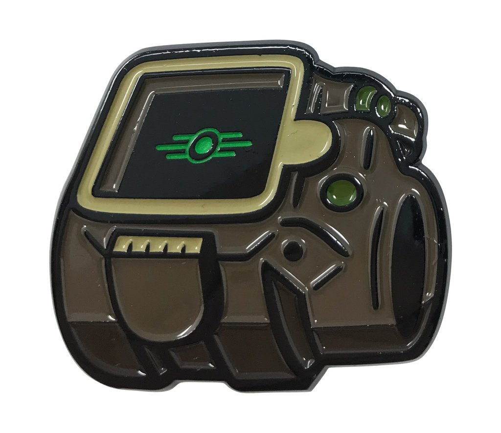 close up of the Pip-Boy from Fallout 4 soft enamel pin on a white background