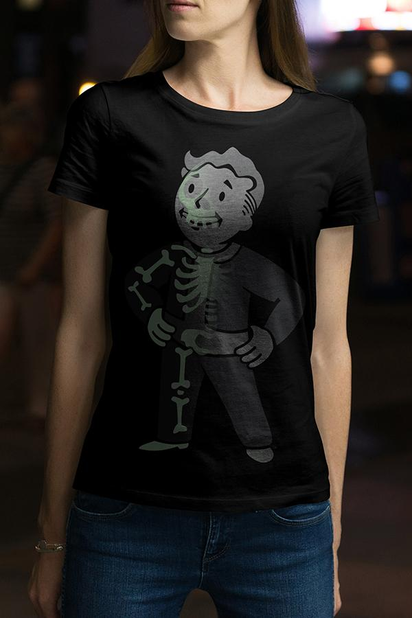 Vault boy from Fallout glow in the dark t-shirt with him doing his signature hands on hips pose, half showing the outline of a skeleton on a female model