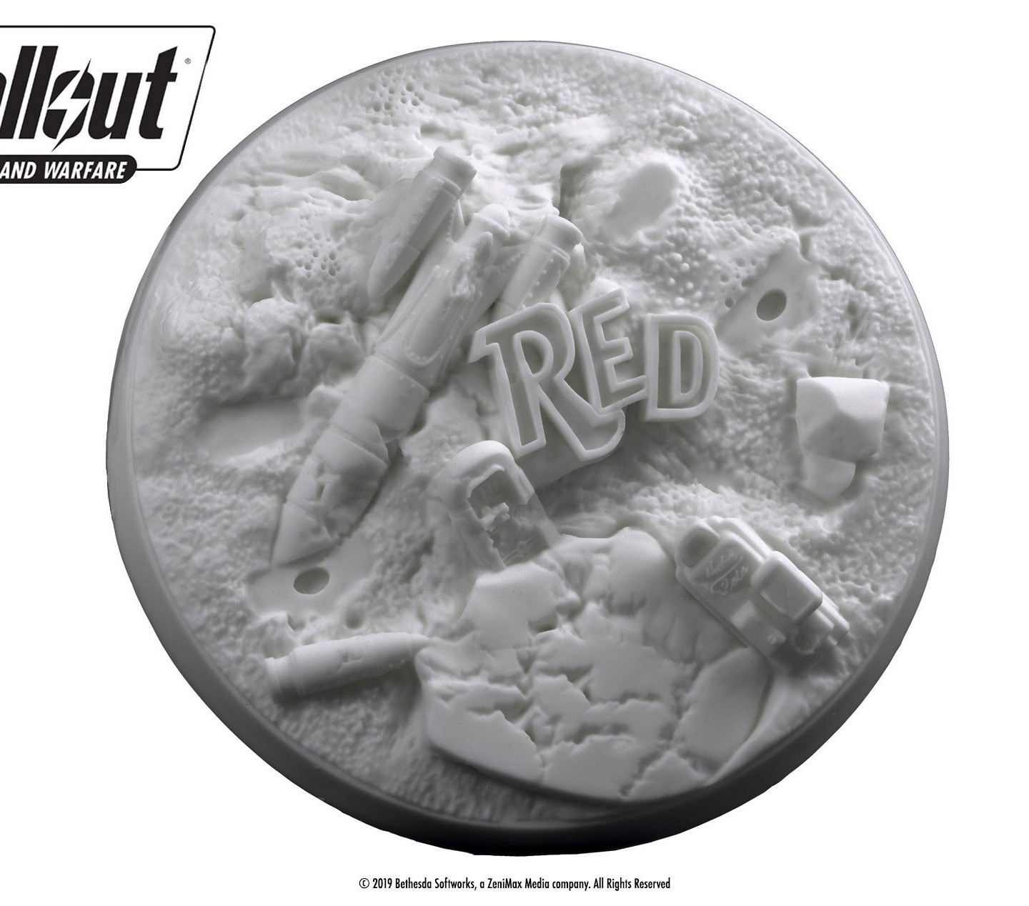 A circular base for tabletop miniatures from Fallout showing a dilapidated Red Rocket gas station parts