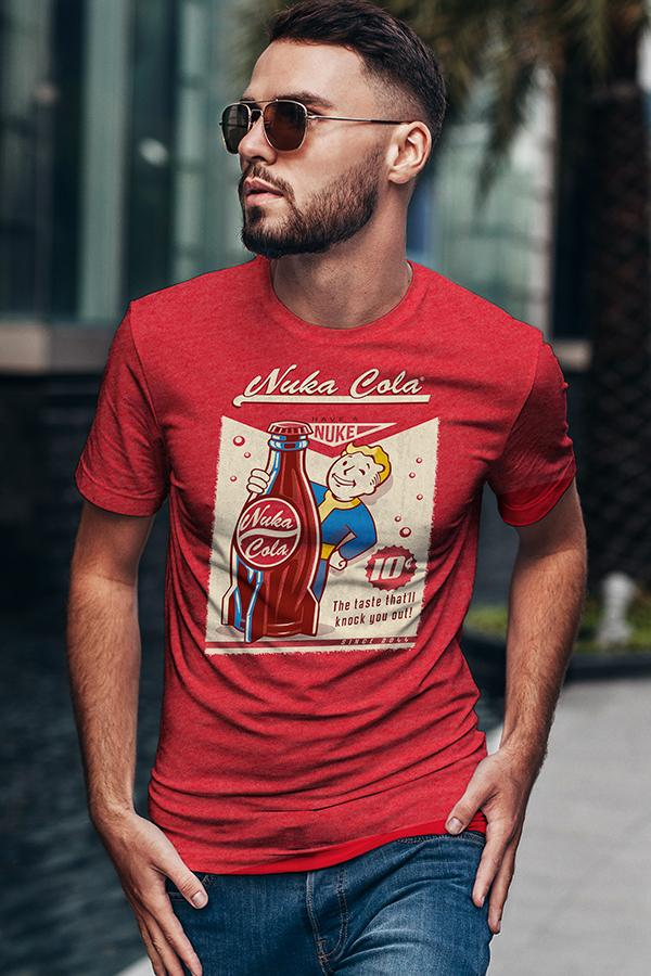 Guy with short hair and sunglasses wearing a vintage style Nuka-Cola from Fallout graphic t-shirt in red featuring Vault Boy holding a Nuka-Cola rocket bottle