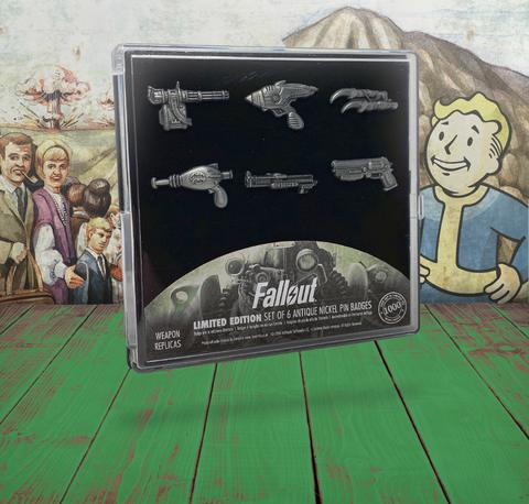 a set of 6 pin badges (enamel pins) shaped after iconic weapons from the Fallout series presented in a custom plastic case