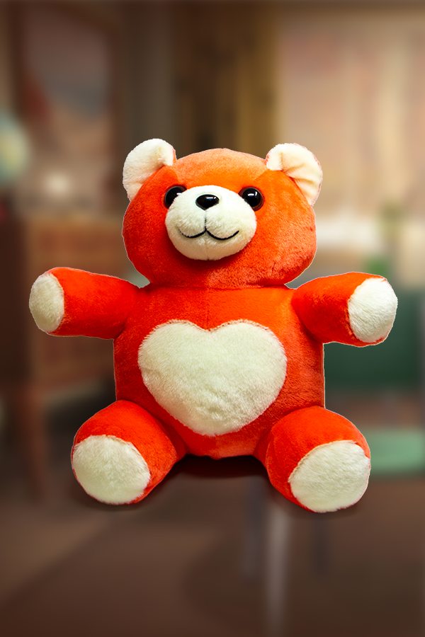 Cute and fluffy Comrade Chubs teddy bear plushie from Fallout in red with a heart shaped tummy