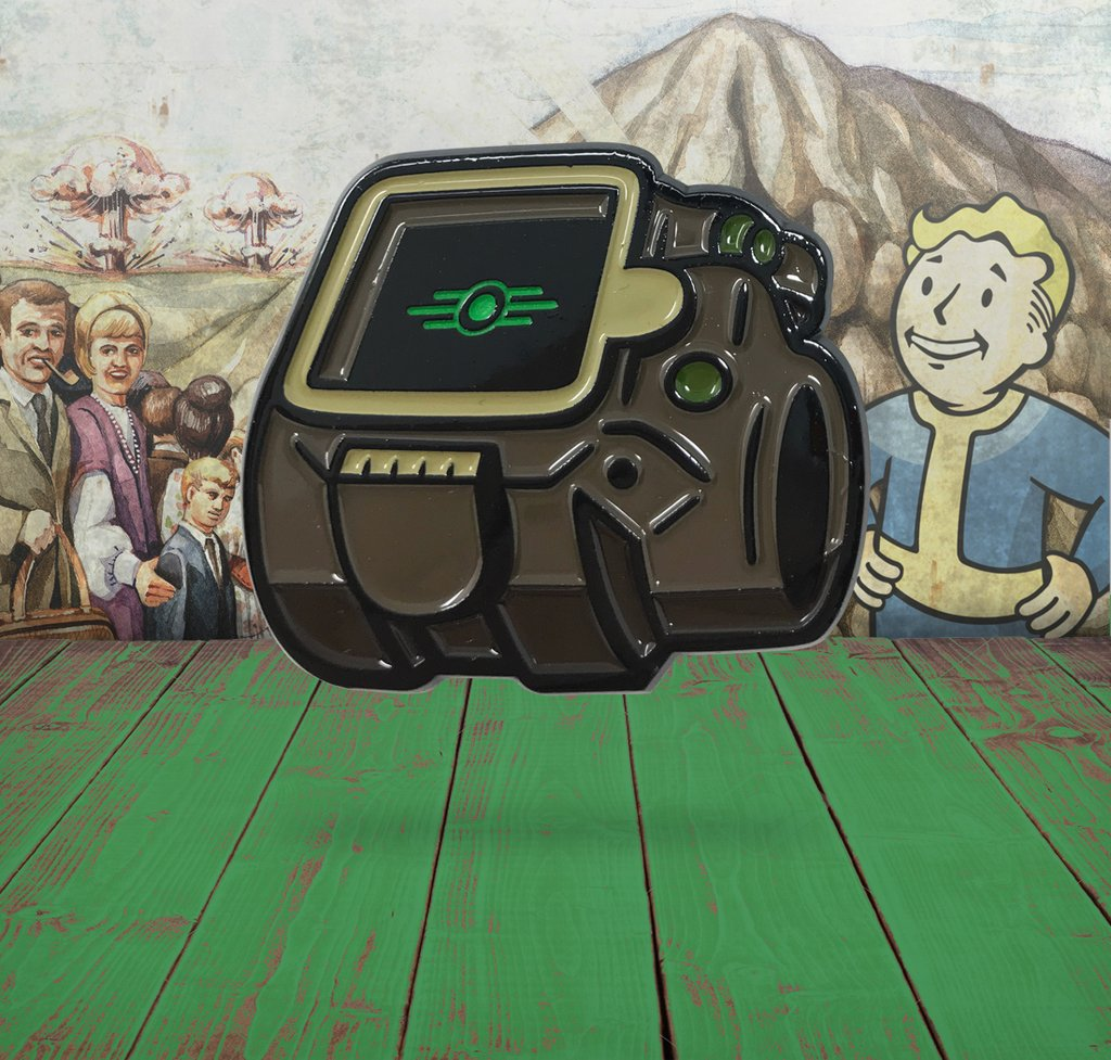 close up of the Pip-Boy from Fallout 4 soft enamel pin with a Vault-Tec themed background