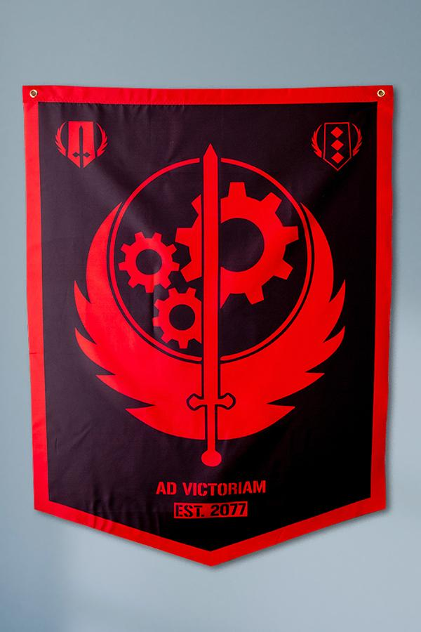 red and black themed Brotherhood of Steel logo from Fallout on a banner hanging up on a wall detail shot