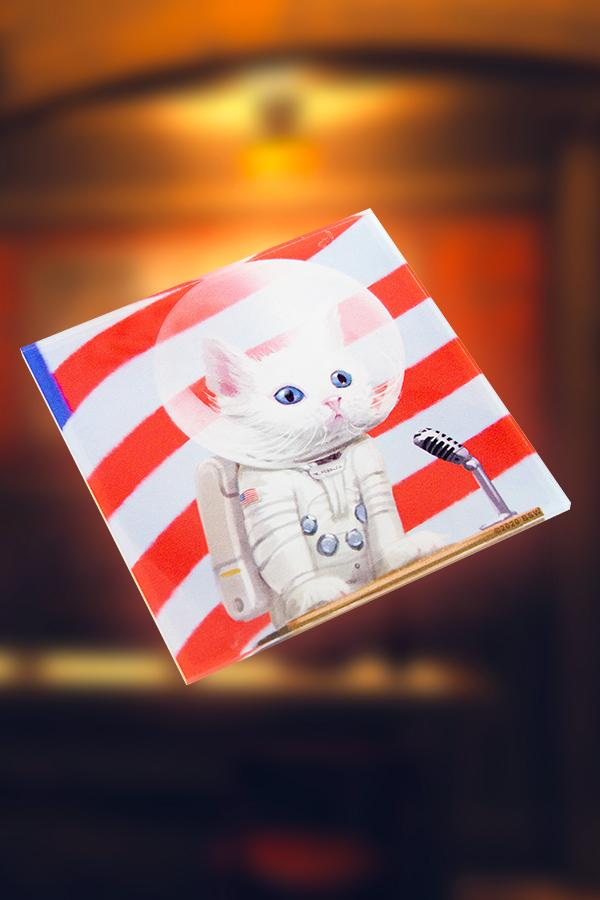 acrylic coaster featuring Mr. Pebbles from Fallout, a white cat wearing a white spacesuit
