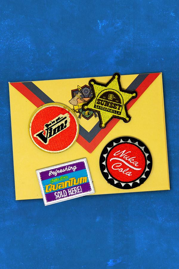 Embroidered patches featuring Vim!, Sunset Sarsparilla, Nuka-Cola Quantum, and Nuka-Cola logos from the Fallout series