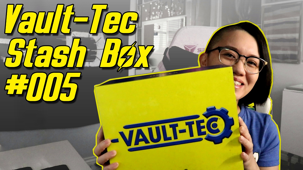 a girl with short hair and glasses holding up a Vault-Tec Stash Box from Fallout by Bethesda Gear, with the text 'Vault-Tec Stash Box 005' in yellow text in the upper left corner