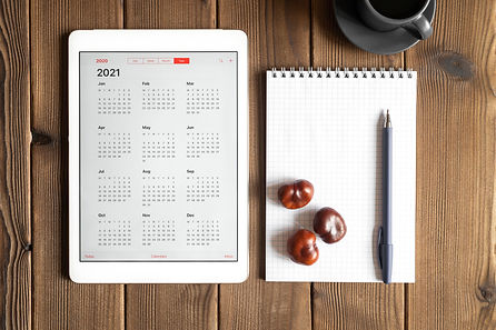 a tablet with an open calendar for 2021