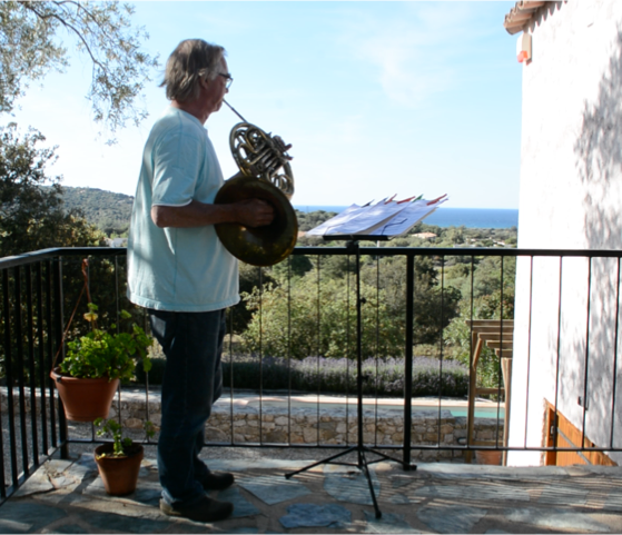Mozart's Horn Concerto played by Howard on a balcony in Corsica