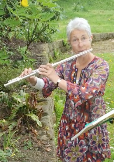 Woodstock by Joni Mitchell played by Alison in her garden, accompanied by a bird