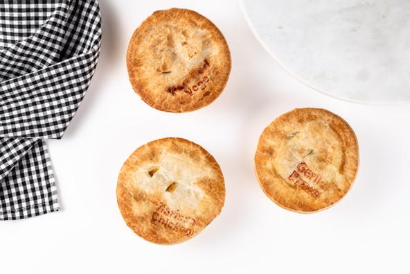 Peri Peri Vegetbale Pie, Harissa Chicken Pie and Garlic Prawn Pie flat lay.jpg