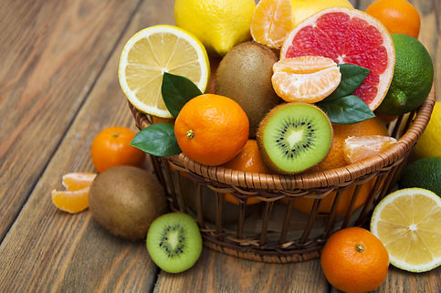 Fresh juicy citrus fruits in a basket on