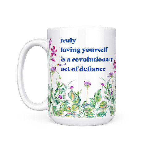 "White mug with floral print & text ""truly loving yourself is a revolutionary act of defiance"""