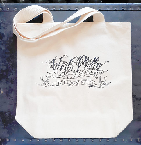 "Off-white canvas tote bag, printed in black with hand-lettered image ""West Philly is the Best Philly"""