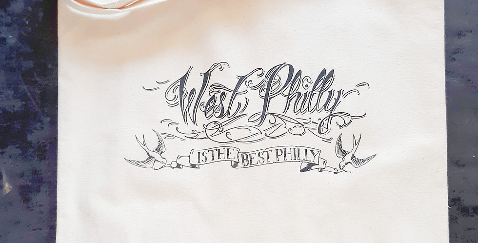 """Off-white canvas tote bag, printed in black with hand-lettered image """"West Philly is the Best Philly"""""""