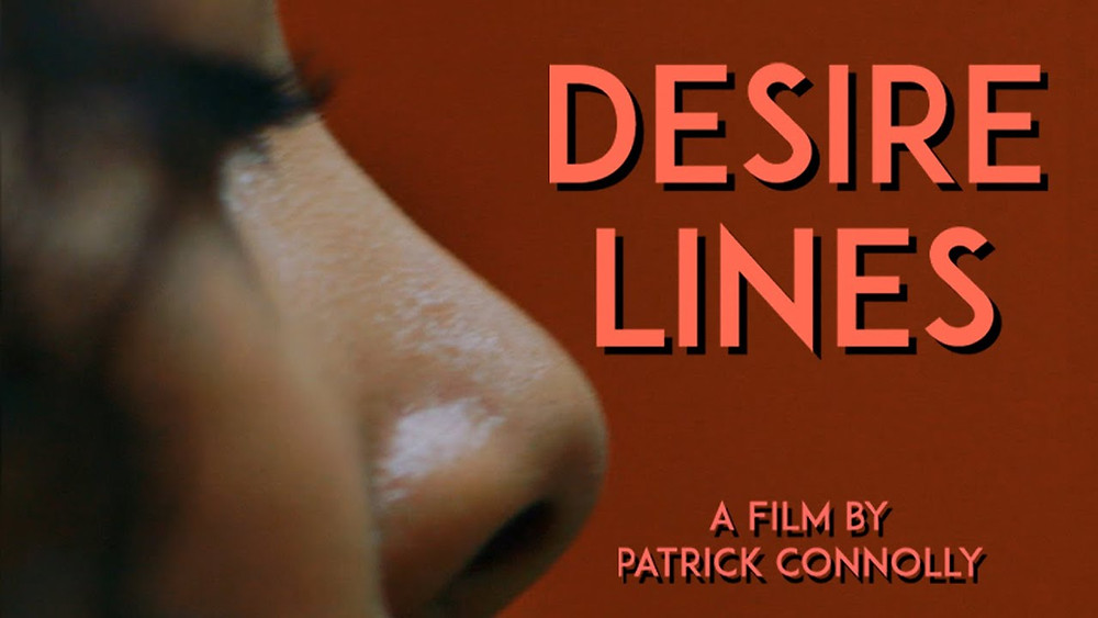 Red background. Half of a woman's face. The words: 'Desire Lines' and 'A Film by Patrick Connolly'