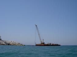 An arm crane on a barge