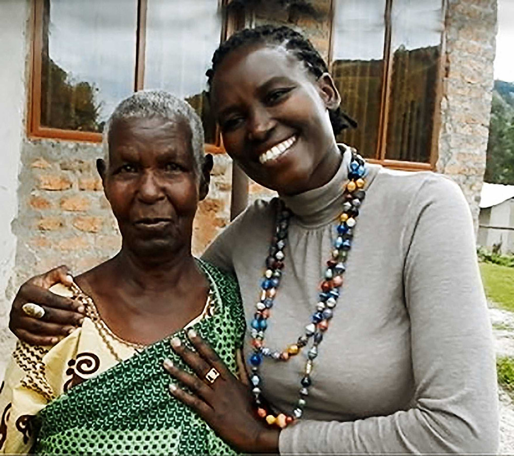 ULA Associate Director Sharon Kukunda helps the elderly caregivers in Uganda