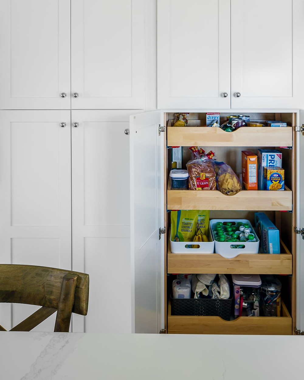 All-white kitchen storage space