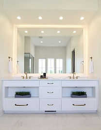 All-white master bathroom with gold hard